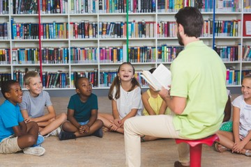 Teacher teaching kids in library