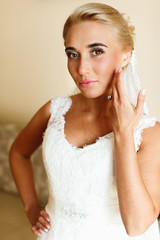 Fabulous blond touches her face delicately