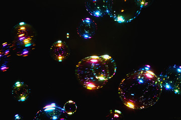Blurred  soap bubble colorful  with  on dark  backgrounds.