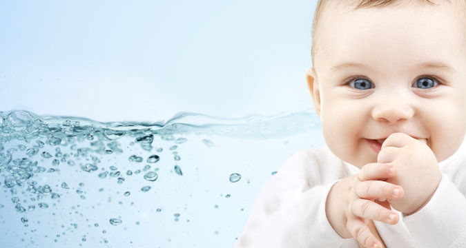 happy baby over blue background with water splash