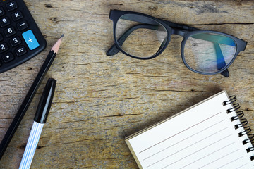 Calculator, notepad ,glasses ,pen and pencil