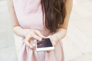 Woman sending message with smartphone