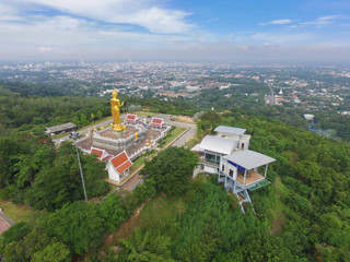 Landscape of Hat Yai, Thailand. Big golden buddha on hill top.