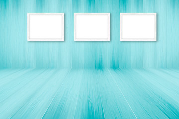 Blue wooden background with white frames, interior decoration