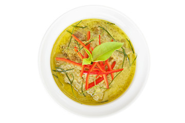 Green curry in bowl isolated on white
