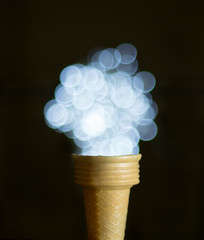 Ice-cream cone and bokeh lights