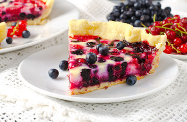 Mix berry tart, pie, cake with raspberries, bilberries, bluberries, red currant and cream