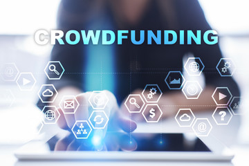 """Woman is using tablet pc, pressing on virtual screen and select """"Crowdfunding""""."""