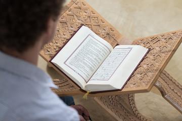 White Muslim Guy Reading The Koran