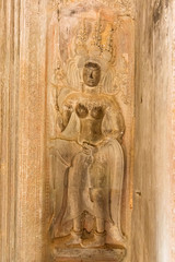 Apsara sculpture on the wall of Angkor Wat, Seam Reap, Cambodia.