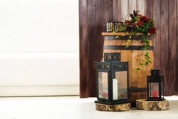 Decorative composition of lanterns and wooden barrel
