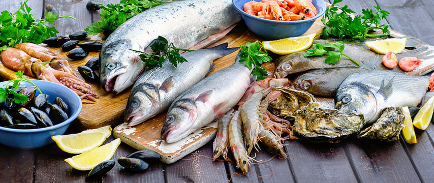 Raw seafood on wooden table.