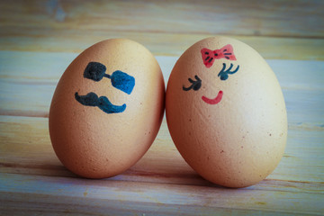 Unusual eggs with the muzzle. The love of two eggs.