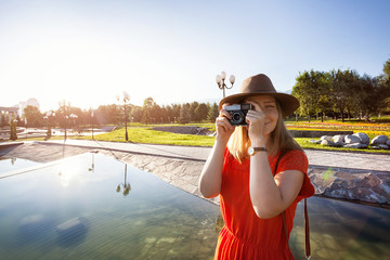 Happy tourist woman with camera