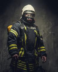 Portrait of firefighter in oxygen mask.