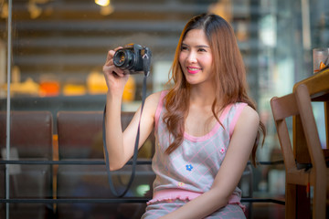 The Travel tourist woman on vacation,And taking pictures from th