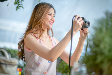 Outdoor summer smiling lifestyle portrait of pretty young woman