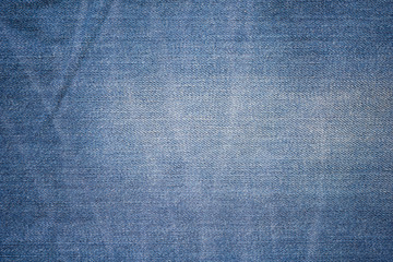 Closeup denim jeans texture. Stitched textured blue denim jeans