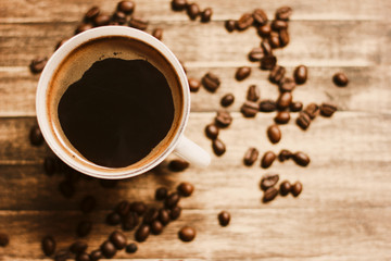 Coffee Beans And Coffee Cup Background./ Coffee Beans And Coffee Cup Background