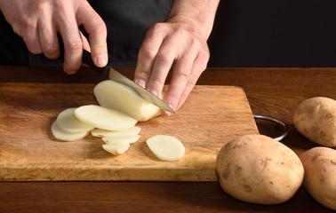 chef chopping onions