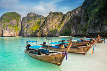 Thailand sea beach view round with steep limestone hills with ma
