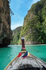 On longtail boat in pile bay on Koh Phi Phi