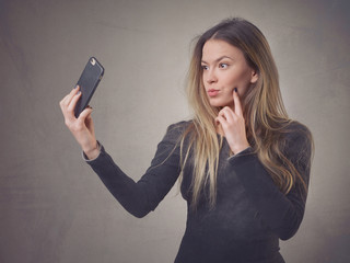 Flirting girl making selfie
