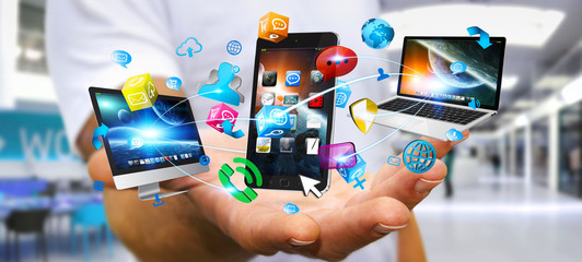 Businessman holding tech devices and icons applications