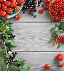 Harvest of  berries  on old wooden table. Copy space for your text. Top view, high resolution product.