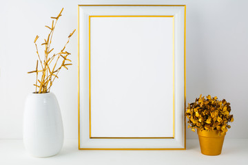 Frame mockup with white vase and golden flower pot