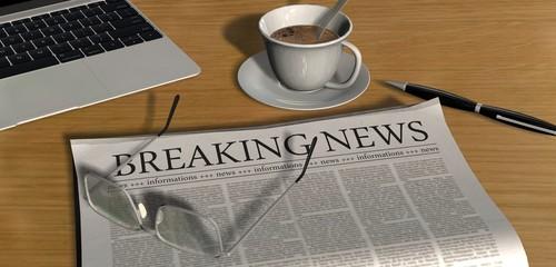 Zeitung auf Schreibtisch - Breaking News