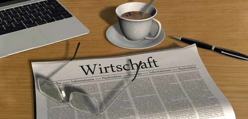 Zeitung auf Schreibtisch - Wirtschaft