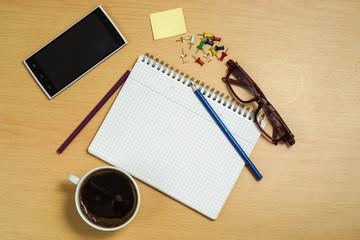 Open blank notebook in office. Top view.