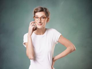 Smiling girl makes phone call