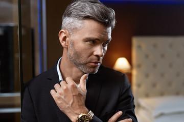 Handsome Man In Fashion Luxury Interior. Wealthy Businessman