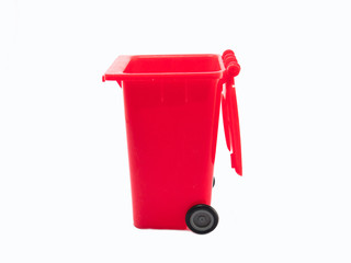 Large red trash can (garbage bin) with wheel, isolated on white background