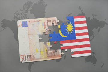 puzzle with the national flag of malaysia and euro banknote on a world map background.
