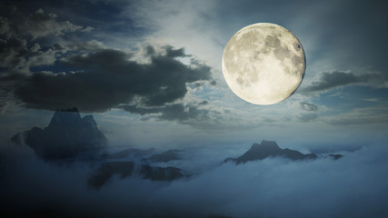 Dramatic sky with tree, full moon and clouds over mountain, Cool