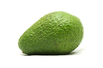 Wall Mural - Green avocado on white background
