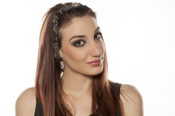 young woman with a headband on her hair