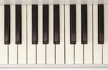 Piano keyboard background with selective focus in motion.Top view