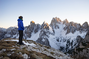 Woman standing in the Dolomite Mountains looking at view, South Tyrol, Italy