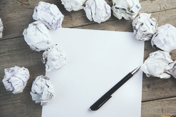paper surrounded with crumpled papers