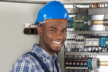 Male Technician Holding Clipboard