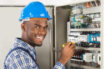 Technician Checking Fusebox With Screwdriver