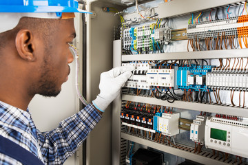 Technician Checking Fusebox