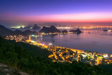Night view of Rio de Janeiro in the horizon after the sunset from the City Park in Niteroi, Brazil