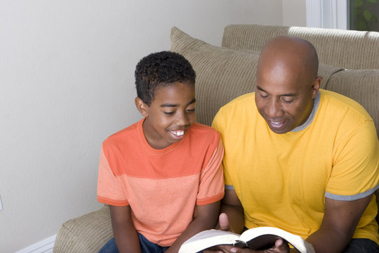 African American Family reading toghter