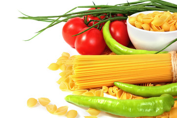 Wall Mural - Different types of raw Italian pasta with tomatoes and other vegetables. Copy space