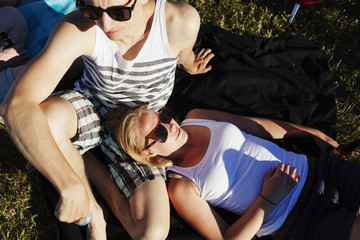 High angle view of woman and man relaxing at picnic